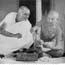 Miraben helping Gandhi repair his Charkha, Wardha, 1936