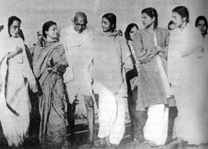 Gandhi walking to the prayer-meeting