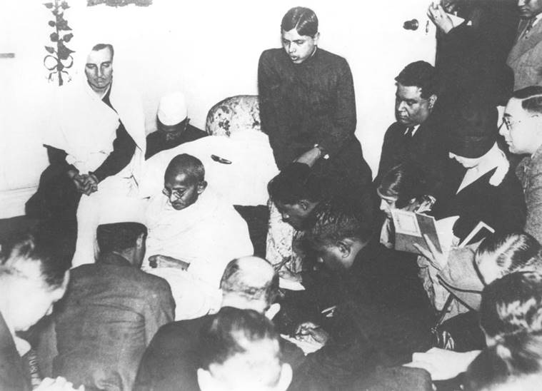 Gandhi with journalists in London