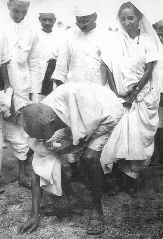 Gandhi picking up Salt to break the law